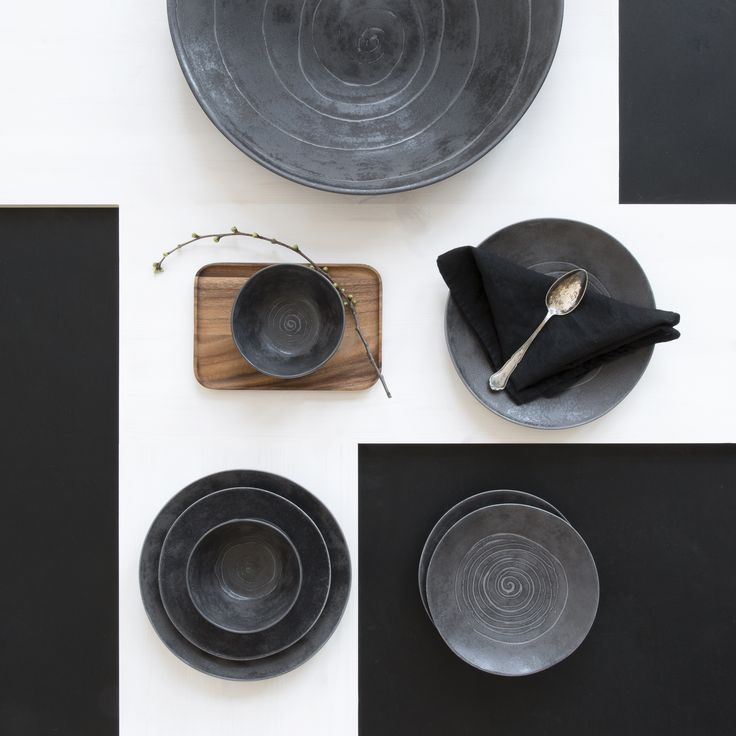 Kivi Tableware | The dark-coloured Kivi collection brings assertiveness and plain style to the table setting. The Kivi ceramicware are real eye-catchers with the colourful Kallio tableware. Designed by Anu Pentik. Made in Posio, Finnish Lapland.