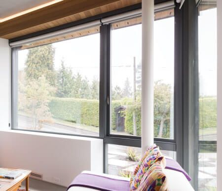 Ultra Series push-out casement stacked over and beside beveled direct set windows.
