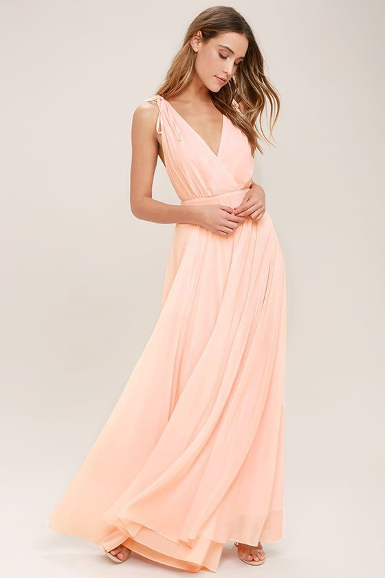 Every twirl you take in the Dance the Night Away Blush Pink Backless Maxi Dress will be absolutely magical! Woven poly forms wide straps, with tying detail and hidden no-slip strips, that flow into a surplice bodice. A sweeping maxi skirt falls below a backless silhouette and fitted waist. Hidden back zipper/clasp.