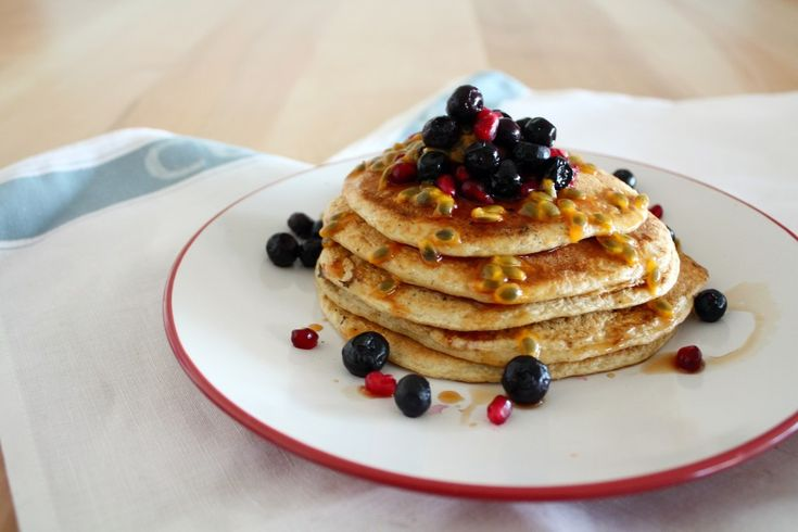 oat flour pancakes with berries and passion fruit syrup