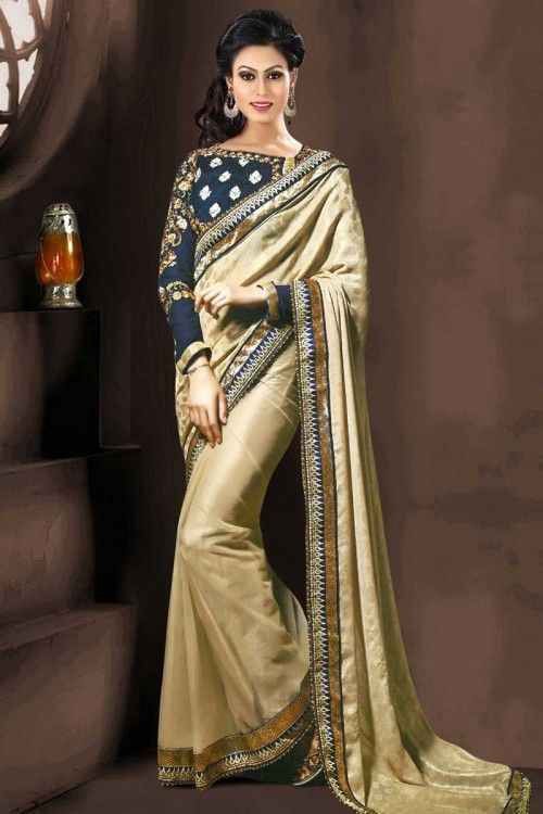 Beige jacquard saree with blue raw silk blouse. Embellished with thread, hand, half half sarees and embroidered embroidery. Saree with Lace Border ,Round Neck Blouse, Quarter Sleeve. It comes with unstitch blouse, it can be stitched to 34,36,38,40 sizes