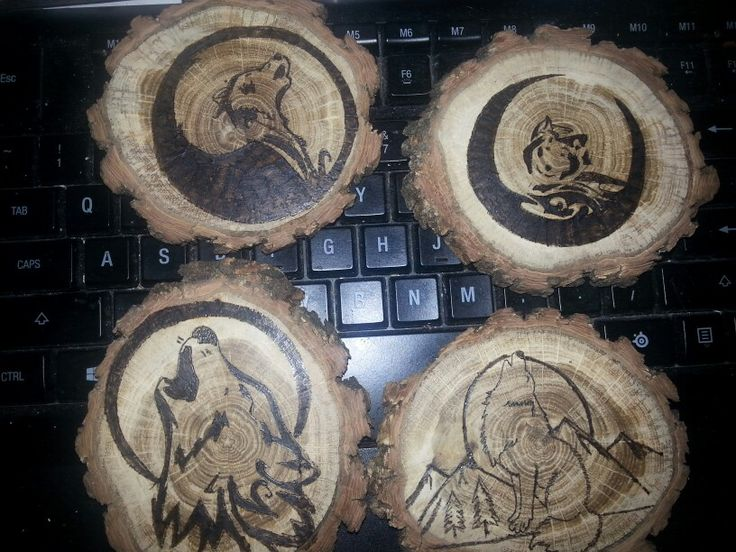 wood burned wolf coasters