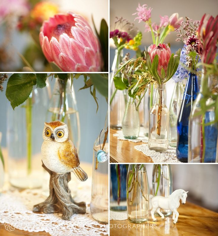 Vintage inspired wedding decor. Jars and bottles filled with fresh native florals. On wooden tables lined with white doily's