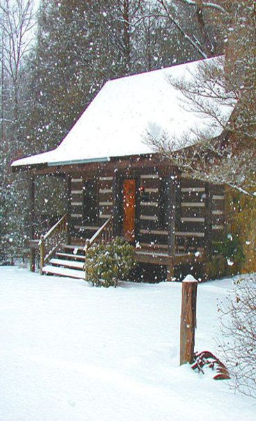 log cabin christmas :) so pretty with the snow.