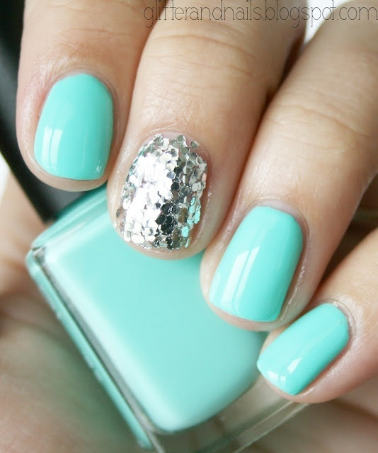 Robin's egg blue/Tiffany's blue and a single glitter covered nail! I love the silver with the bright pastel (that's an oxymoron..)