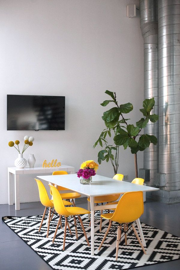 Mavens HQ Citrus Studios Kalika Yap office loft styled by Erika Brechtel conference table yellow Eames chairs black white IKEA rug