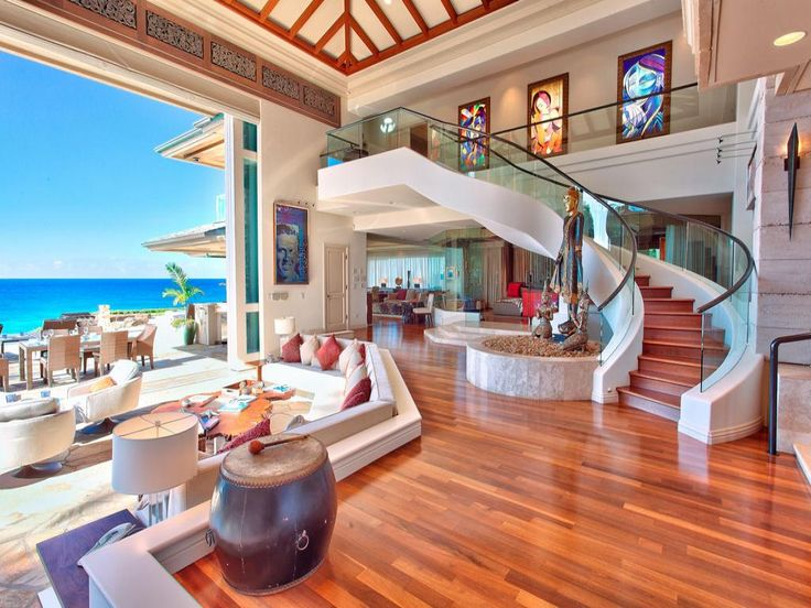 amazing beach home interior with wooden floor plus elegant stairs beside living space also nice view on balcony