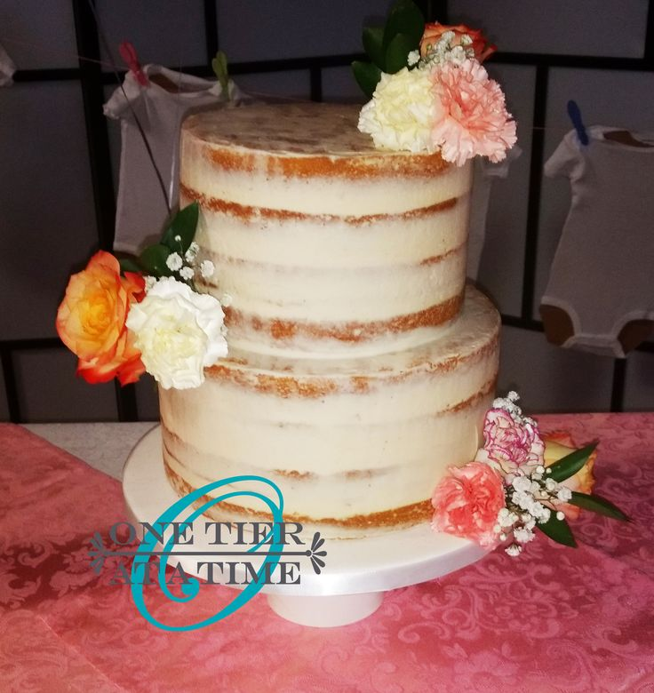 Naked two tier cake with fresh flowers