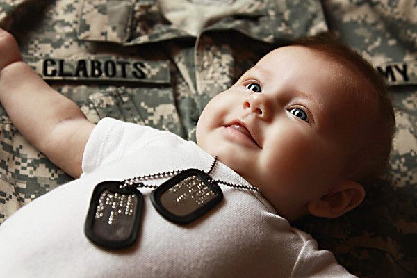 @Kati Zumwalt  Use papa's dog tags and Darin's uniform top military or police? Cute!