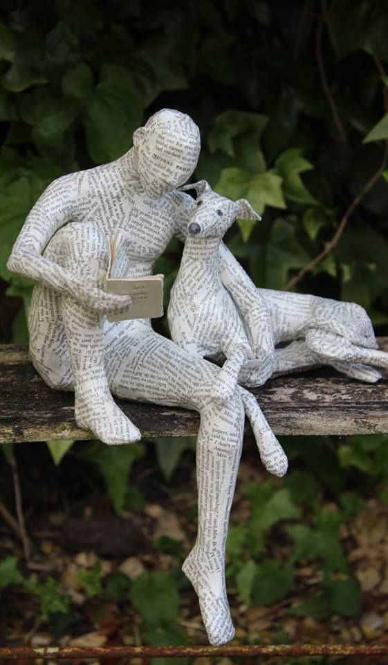 Man and his dog sculpture by Lorraine Corrigan - photo by Lorraine's Hounds, via Facebook; wire covered with paper from vintage books