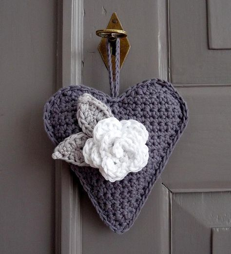 Crochet heart hanger and rosette by Ingrid Danvers of Studio 92 Designs. Edit to Add: The pattern for the heart is available for free by Made by BeaG on Flickr. The rose and leaf patterns are by Lucy of Attic24.