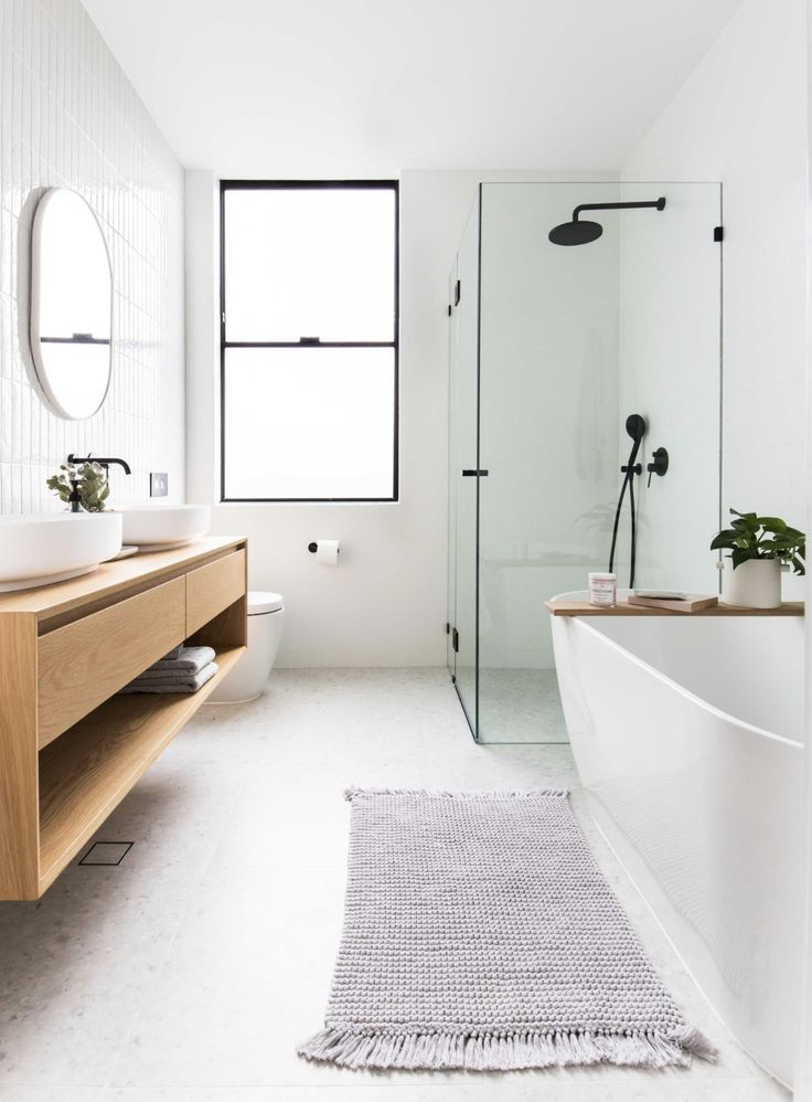 clean, minimal bathroom inspiration // black framed windows and class with white walls and warm wood vanity