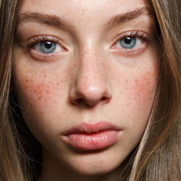 Perfectly imperfect brows and freckled faces at Emanuel Ungaro.