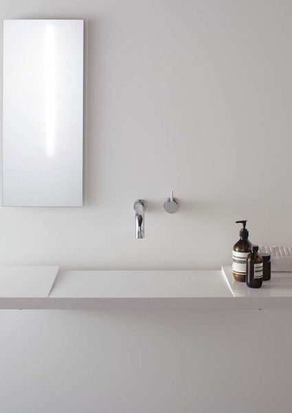 Slanted sink with channel drain. So simple and gorgeous. Ohhh and those Aesop products...