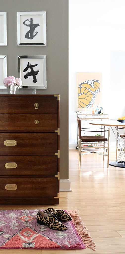 "The campaign dresser in the entryway was found after much diligent searching. ""Eventually I found this piece on Craigslist all the way out in Long Island. I had the brass refinished, but the wood was in excellent shape. It was a major score at $65!"""