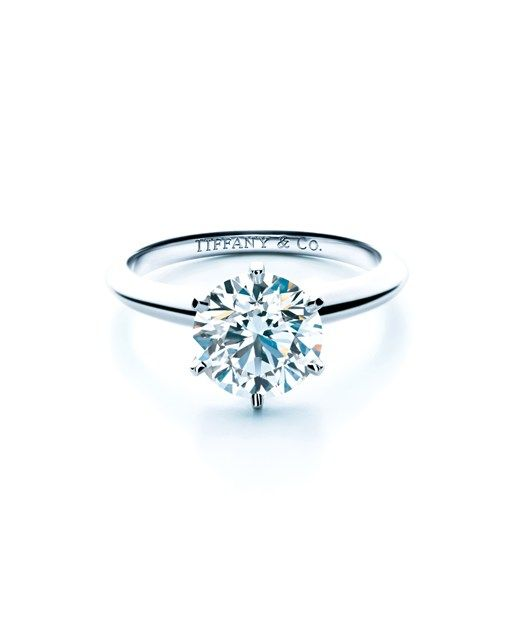 Perfect engagement ring. 6 prong platinum with a larger solitaire.