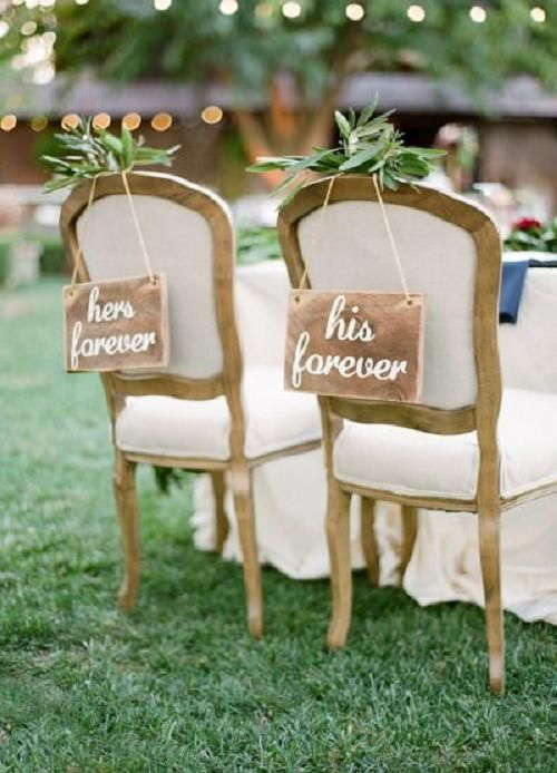 rustic wedding chair with wood sign  Personally like mr and Mrs. But you could do whatever renaissance language