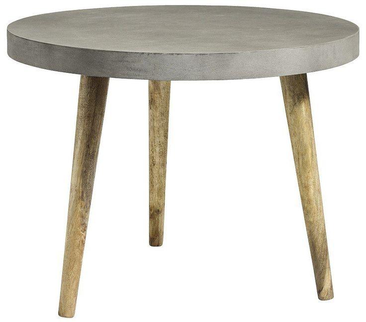 Nordal+Spisebord+-+Grå+-+Ø100+cm+-+Moderne+og+nordisk+inspireret+rundt+spisebord.+Bordpladen+har+et+betonlook,+som+gør+bordet+rustikt+og+råt.+Træbenene+sørger+for+at+bryde+det+ellers+rå+look+og+skaber+en+super+god+kontrast+til+bordpladen.+Det+danske+design+er+meget+populært+og+tilfører+hygge+og+nordisk+stil+til+hjemmet.+Findes+også+som+sofabord.+