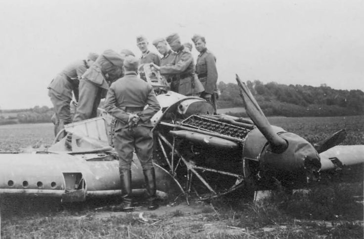 "Hurricane Mk I TP-Z is examined by German army officers after it was removed from farm buildings near Dormans, into which P/O Ian D Hawken of No 73 Squadron RAF crashed at 14.20hrs during a patrol from Échemines on 3 June 1940. The 24-year-old pilot was killed in combat near Épernay, during which P/O Hugh W ""Chubby"" Eliot claimed an Me 110 southwest of Rheims at 14.00hrs and F/L Charles WK ""Doug"" Nicholls and Sgt Alfred E ""Alf"" Scott another probably shared near Sainte-Marie-Chevigny."