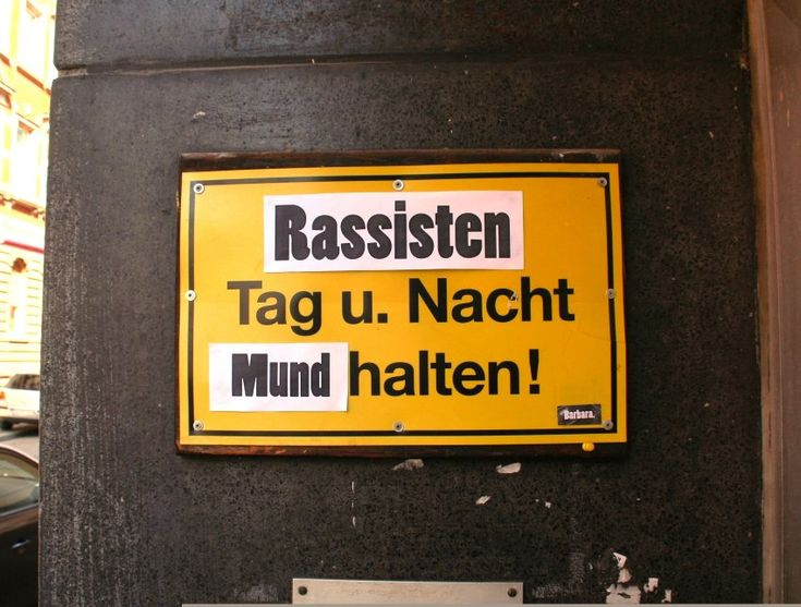 """Racists shut your mouth, at day and night! - street art artist """"Barbara"""""""