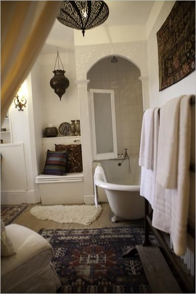 Bathroom- I like the idea of the claw foot tub, kilim, and drapey curtain