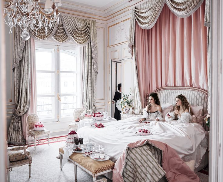 Let Them Eat Cakes - Interiors designer Thierry Despont assembled a cast of 800 stonemasons, upholsterers, gilders, and painters to bring the hotel back to its former glory. Actors Anna Brewster (left) and Noémie Schmidt—who appear in the new Ovation drama Versailles—wear Chanel dresses; select Chanel boutiques.   Fashion Editor: Phyllis Posnick