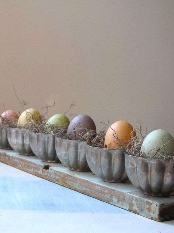Vintage tin moulds to hold eggs