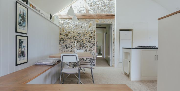 Image of the dining and kitchen area of Quaker Barn - a modern barn conversion holiday home in Norfolk