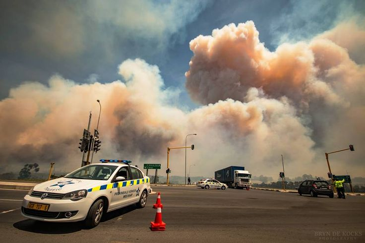 Houses Burnt as Thick Smoke Billows Above Cape Town from Sir Lowry's Pass Fire