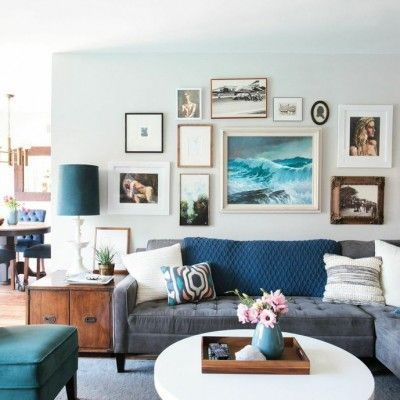 Mid Century Modern {my latest HomeGoods project} I like the round white coffee table & navy/aqua accents.