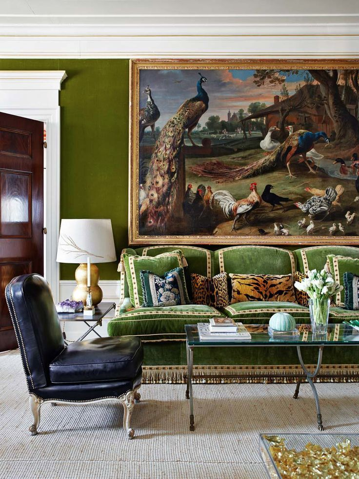Velvet wallpaper, sofa with trim and fringe, animal print pillow, leather chair.  All my favorite things.  Decor Design Review