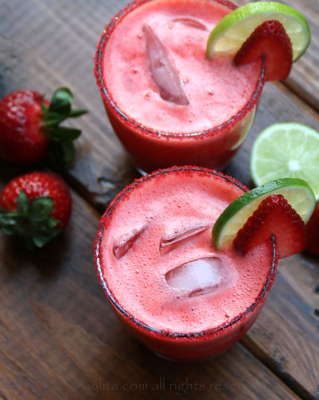 Homemade strawberry margarita recipe made with fresh strawberries, lime juice, sugar or honey, orange liqueur, and tequila. Can be made on the rocks or frozen.