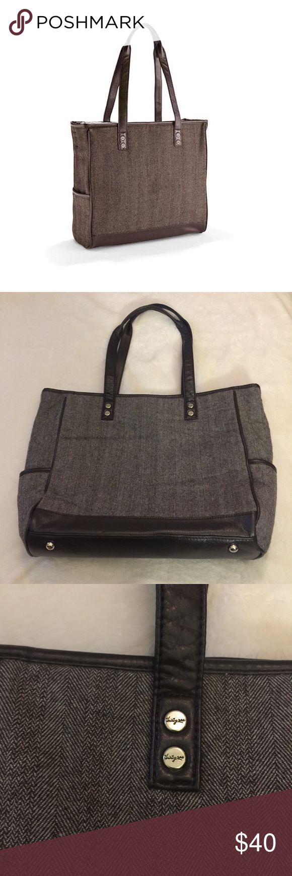 """Like new thirty one Cindy tote Excellent condition thirty one Cindy tote in brown herringbone. Has 2 side slip pockets on the outside, zipper to main pocket, 1 inner zip pocket, and 3 inner slip pockets. Has D ring inside on one side and a lobster clasp on the other. Very nice large bag. Perfect for the office or everyday! 14""""H x 15""""L x 5""""D thirty one Bags Totes"""