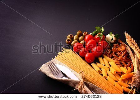 seasonal black table with pasta and cutlery