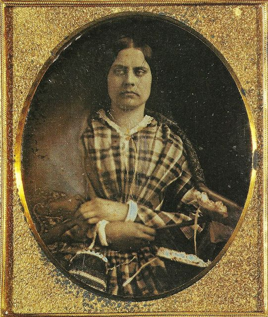 (Could be inspiration for Lincoln's disguise... Just with a solid dress and Scottish plaid shawl.) -Susan B. Anthony -- Casting her first vote; going to jail. | Viral History