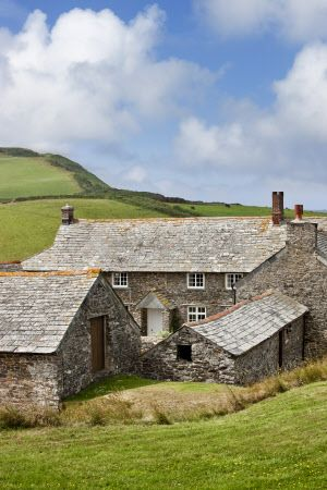 Trevigue Farm, a sixteenth-century farmhouse around a cobbled courtyard, now a National Trust bed & breakfast establishment, at St Gennys,Crackington Haven, Bude, Cornwall