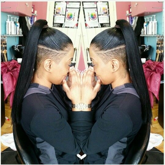 Clean ponytail with both sides and under shaved
