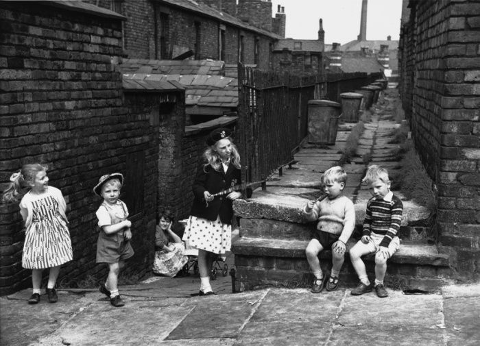 Children play in the alleys behind their terraced houses in Salford, Manchester. 1962.