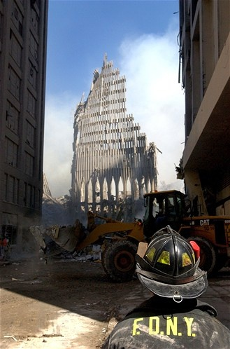 A New York City firefighter looks at the remains of one of the twin towers of the World Trade Center on Sept. 13, 2001