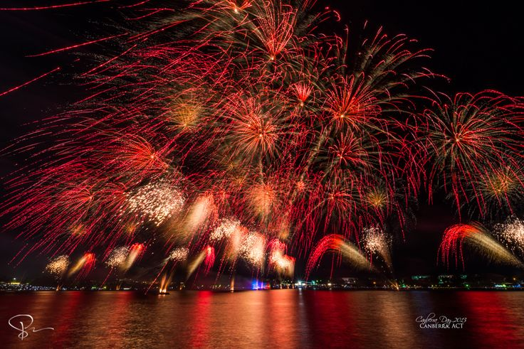 Taken on Canberra Day 2013 from Lake Burley Griffin. Having a wide angle lens helps with getting in a bigger view from a low angle, adding to the perspective of these wind-driven fireworks. My previous attempt of fireworks at Lake Burley Griffin can be seen on 2012′s Australia Day celebration here: http://sactyr.com/wp/canberras-australia-day-2012/  For better quality, check out here: http://sactyr.com/wp/canberra-day-2013/  Exposure: 10s Aperture: f/13 Focal Length: 11 mm ISO Speed: 200