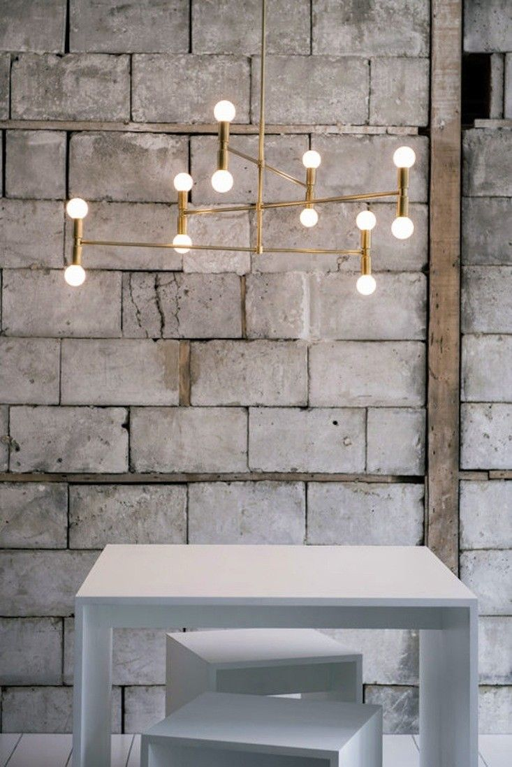The brass trend continues. We currently have our eyes on the bare-bulb elegance of Lambert & Fils lights.