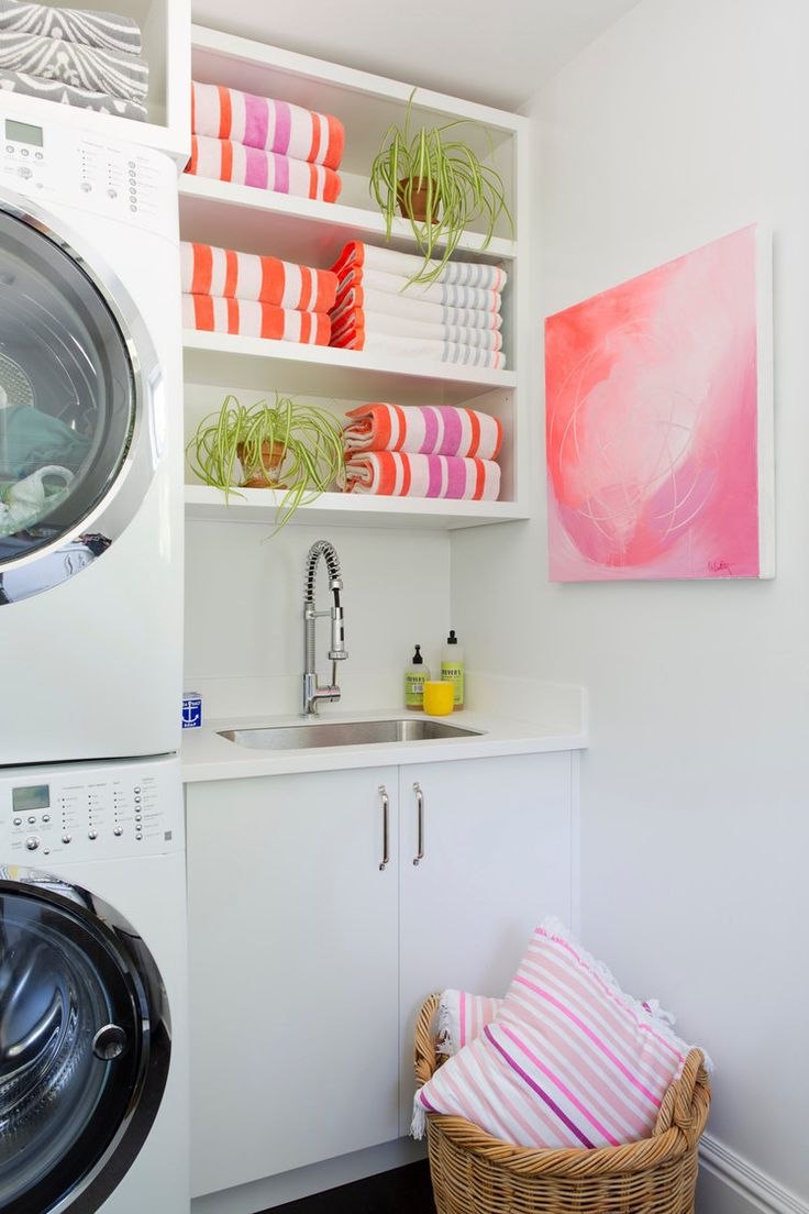 White + Bright with Pops of color + stacked washer dryers | d2 Interieurs