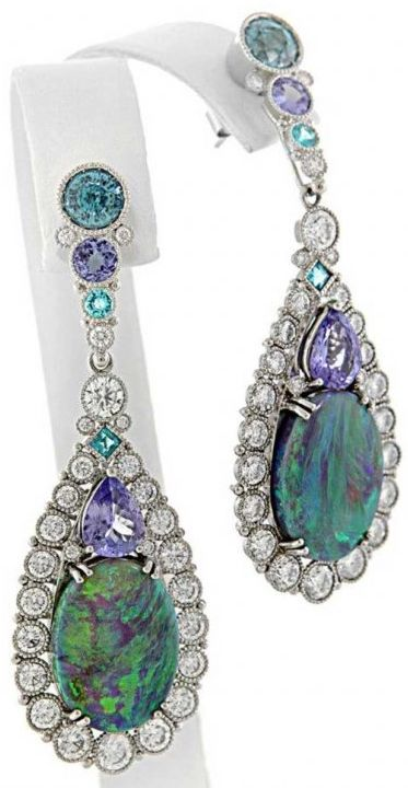 AGTA Spectrum Awards - Best Use of Color:  Platinum earrings featuring removable opal enhancers accented with blue zircons, tanzanites, paraiba tourmalines and diamonds by Deirdre Featherstone. Via CIJ Jewellery Magazine.