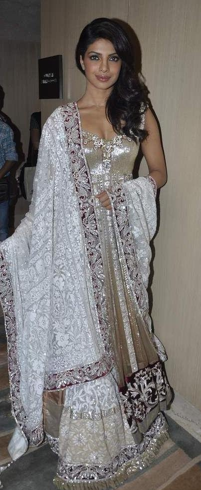 Glamorous white and gold Manish Malhotra ensemble.