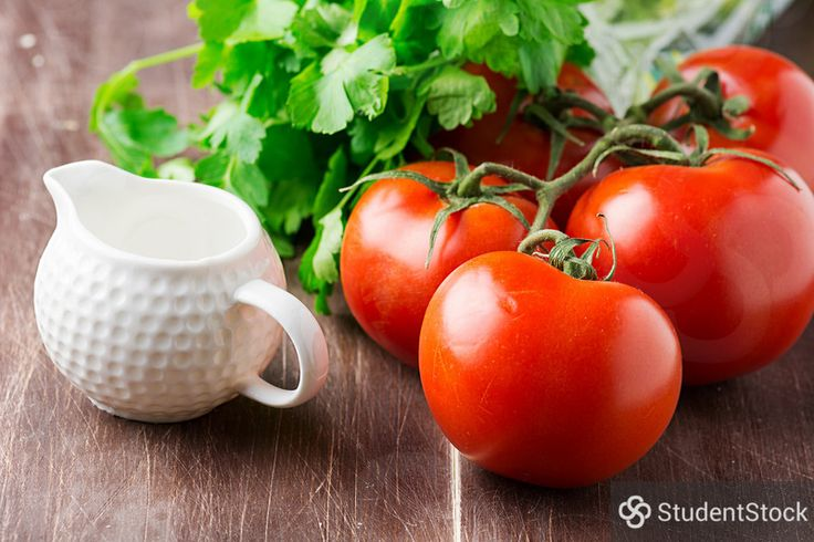 """StudentStock - """"Tomatoes on vine, parsley and creamer on wooden table"""" by Vladislav Nosick"""