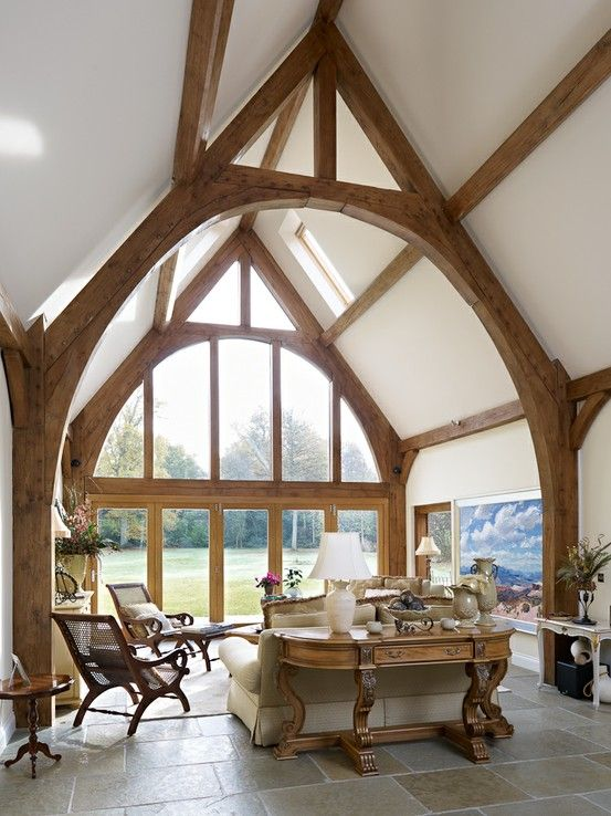 I love the double height - beautiful although I think I might have my kitchen/ breakfast room there... Border Oak - Full glazing and oak cruck frame in a new build barn.
