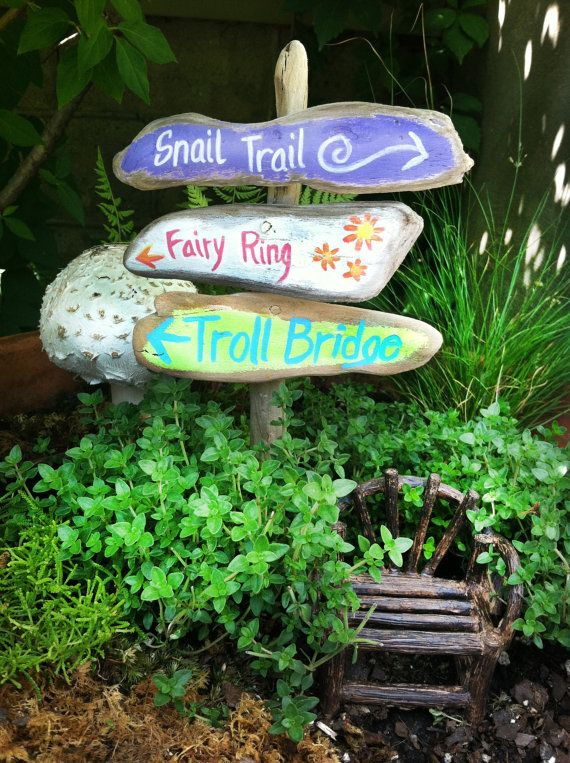 fairy garden signpost painted signs fairy ring snail trail troll bridge on a rustic sign post minature