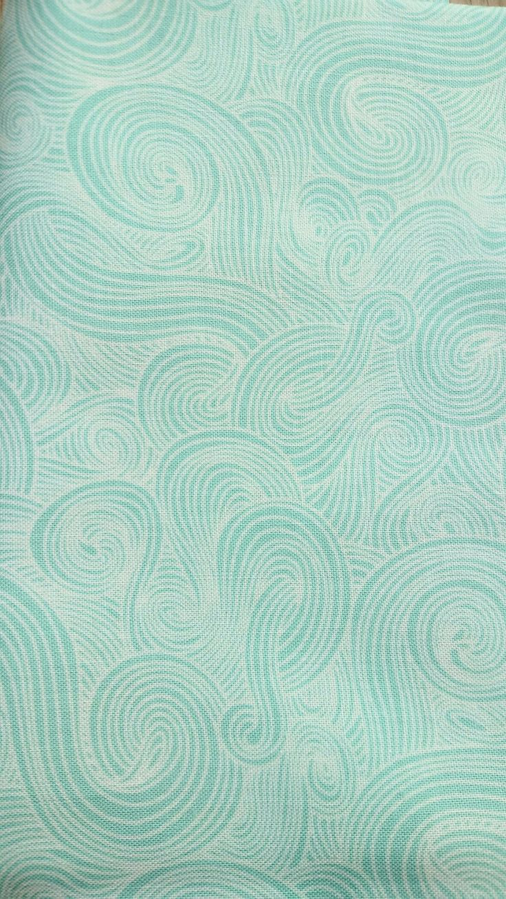 Concentric waves aqua.  Studio E fabrics.