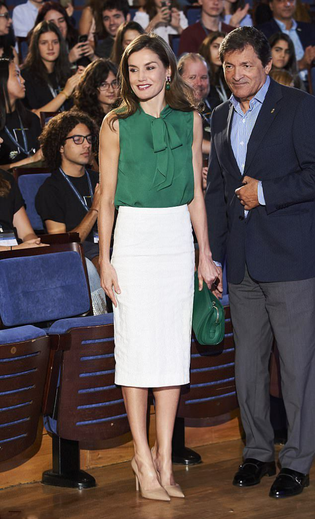 Queen Letizia of Spain resplendent in a figure-hugging Roland Mouret crisp white, below-the-knee pencil skirt and emerald green top, she paired with nude pointy heels and a matching green clutch. The Spanish Queen was the main attraction as she arrived at music awards on Friday July 21, 2017.