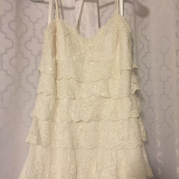 Melissa Sweet wedding gown Beautiful vintage style Melissa Sweet lace wedding gown. Sweetheart neckline with spaghetti straps, button details on the back. Ivory color with beaded details that give it a beautiful subtle sparkle. David's Bridal Dresses Maxi